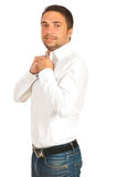 Confident man buttoning collar shirt Royalty Free Stock Photography