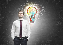 Confident man and colorful light bulb Stock Photography