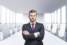Confident man with crossed hands. Panoramic meeting room. New York view, Stock Photography