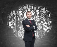 Confident man and dollar sign cloud Stock Photo