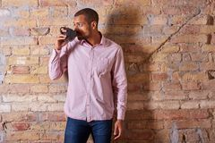 Confident man drinking coffee Royalty Free Stock Images