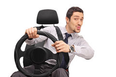 Confident man driving and whistling Stock Photography