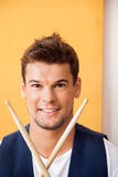 Confident Man With Drumsticks In Recording Studio Royalty Free Stock Photo