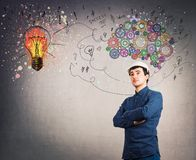 Mental development lightbulb symbol. Confident man engineer wearing protective helmet, hands crossed over gray wall. Idea concept, creative thinking as colorful stock illustration