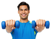 Confident Man Exercising With Dumbbells Stock Photo