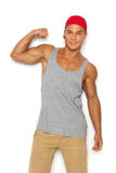 Confident Man Flexing Biceps Stock Image