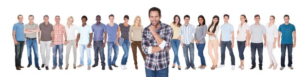 Confident man with friends against white background Royalty Free Stock Image