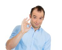 Confident man giving OK sign Stock Photography