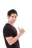 Confident man giving thumb up gesture Royalty Free Stock Image
