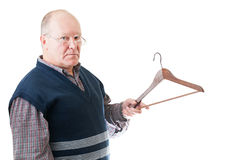 Confident man in glasses with empty cloth hanger Royalty Free Stock Image
