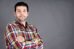 Confident man on grey Royalty Free Stock Photography
