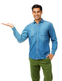 Confident Man With Hand In Pocket Holding Invisible Product Stock Photo