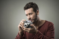 Confident man holding a vintage camera Royalty Free Stock Image
