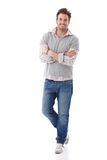 Confident man in jeans smiling Royalty Free Stock Images