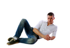 Confident man laying on the floor Stock Photos