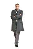 Confident man posing in coat Stock Photography