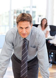 Confident man posing in front of his colleague Royalty Free Stock Images