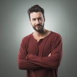 Confident man posing on gray background Stock Image