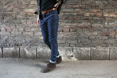 Confident man posing in selvedge  jeans Stock Images