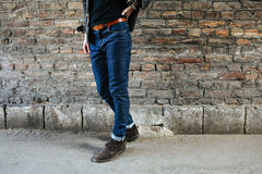 Confident man posing in selvedge  jeans Stock Photos