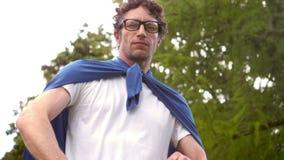 Confident man pretending to be superhero