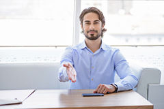 Confident man proposing to sit down stock images