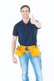 Confident man showing thumbs up sign Royalty Free Stock Image