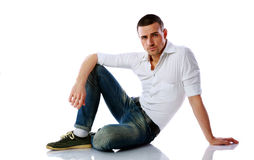 Confident man sitting at the floor Stock Photography