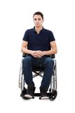 Confident Man Sitting With Hands Clasped In Wheelchair. Full length portrait of confident man sitting with hands clasped in wheelchair isolated over white Royalty Free Stock Photo