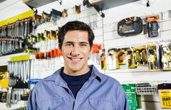 Confident Man Smiling In Hardware Shop Royalty Free Stock Images