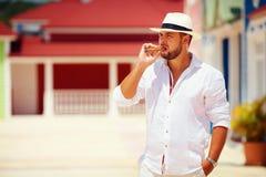 Confident man smoking cigar on caribbean street Royalty Free Stock Images