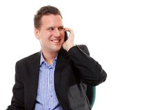 Confident man speaking on his mobile and smiling Royalty Free Stock Photo
