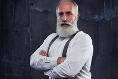 Confident man standing with arms folded  in studio Royalty Free Stock Images