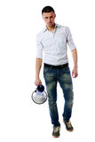 Confident man standing with megaphone Royalty Free Stock Photo