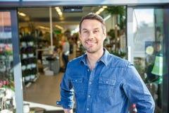 Confident Man Standing Outside Flower Shop Stock Photos