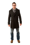 Confident man standing in winter coat smiling. Smart casual dres Stock Images