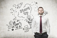 Confident man and start up icons Royalty Free Stock Photos