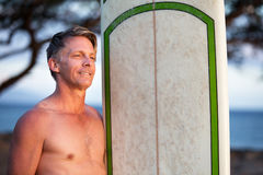 Confident Man with Surfboard Stock Images