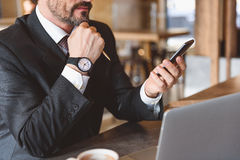 Confident man using mobile phone in cafe Stock Photography