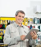 Confident Man Using Tablet Computer In Hardware Stock Images
