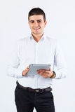 Confident man using tablet Royalty Free Stock Photo