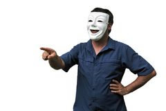 Confident man wearing a happy face mask pointing stock images