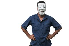 Confident man wearing a happy face mask standing with arms at h royalty free stock photo