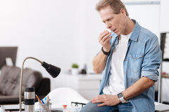 Confident man wiping his nose Stock Images