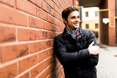 Confident  man young businessman looking to the side portrait ag. Confident  entrepreneur man young businessman looking to the side portrait against city Royalty Free Stock Images