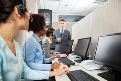 Confident Manager In Discussion With Customer. Service representatives in office Stock Photos