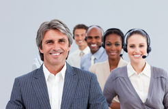 Confident manager in front of his team Royalty Free Stock Photo