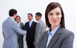 Confident manager with her team in the background. Business concept Stock Photos