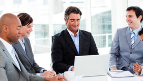 Confident manager in a meeting with his team Royalty Free Stock Photos