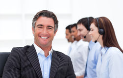 Confident manager presenting a call center Royalty Free Stock Photos